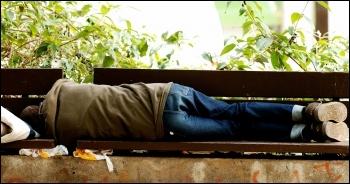 Rough sleeper, photo by Pedro Ribeiro Simões (Creative Commons)}