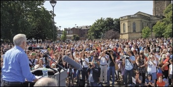 Jeremy Corbyn speaking to one of many mass audiences, photo Steve Score