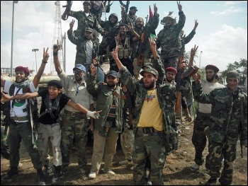 Some of the rebels fighting Gaddafi in 2011, photo by Magharebia (Creative Commons)