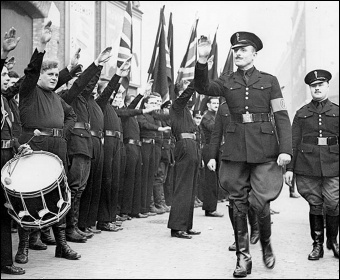 Fascist leader Oswald Mosley inspects parading Blackshirts