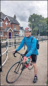 Chris Newby on the sponsored bike ride, photo by Naomi Byron
