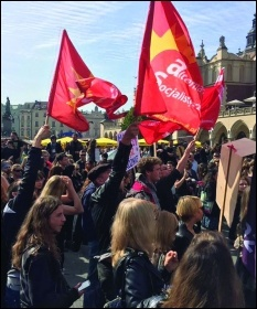 Socialist Alternative members with flags at a large pro-choice demo