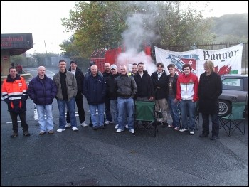 CWU strike: Bangor postal workers pose for a pic on the picket lines, photo Bangor Socialist Party