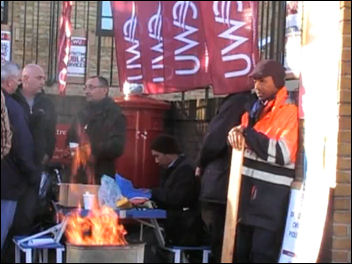 Postal workers on strike in East London, photo by The Socialist