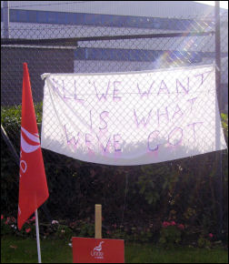 A banner on the Superdrug picket line, photo Alistair Tice