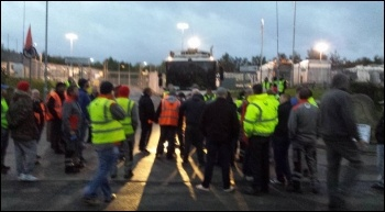 About 50 workers on the picket line on 17 October block lorries coming out of the yard photo Philip King
