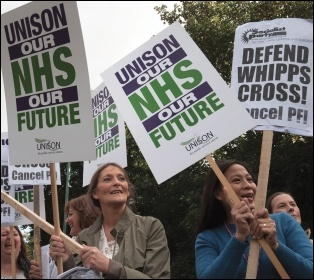 Health workers and campaigners marching against cuts at Whipps Cross Hospital, east London, photo Paul Mattsson