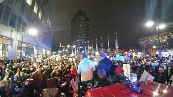 Over 5,000 people came out into the streets of Boston photo