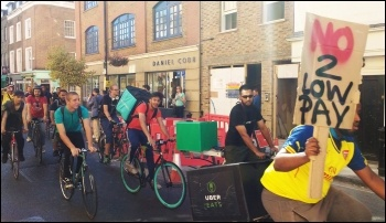 UberEats couriers striking against low pay, photo by Scott Jones