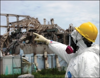 Eight years on, the ruins of the Fukushima power plant are still highly radioactive and hold huge amounts of toxic water, photo Mike Weightman/IAEA (Creative Commons)