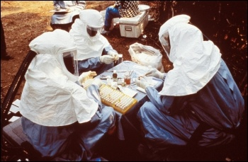 Ebola scientists testing samples, photo by US Centers for Disease Control and Prevention