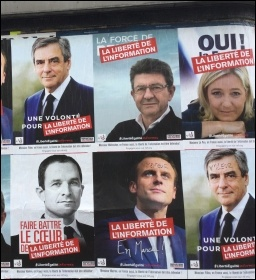 Rising left-winger Jean-Luc Melenchon (top centre), a wall in Paris, photo Judy Beishon