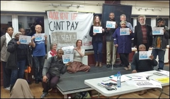 One Housing tenants in east London discussing the fight against their 40% rent hike, photo Scott Jones
