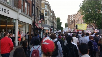 Marching through Kensington to chants of