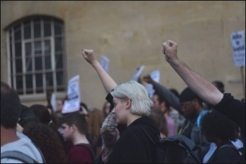 Grenfell: Clenched fists during a minute's silence for the victims, 17.6.17 , photo Mary Finch