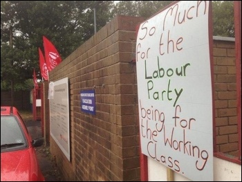 A placard tied to the gates by binworkers. Jeremy Corbyn wants to change Labour, but for Birmingham bin workers, itÂ's not yet happening here., photo Birmingham SP