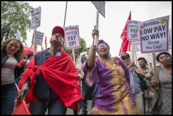 Barts NHS striking cleaners and porters in the Unite union demonstrate in Whitechapel, photo Paul Mattsson