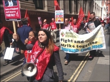Bank of England strikers march to another site of the bank and an event attended by the bank's governor, then back to their picket line. 3.8.17, photo by Sarah Wrack