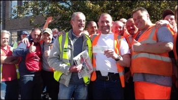 Socialist Party and PCS union activist Bill Murray presented a strike fund donation from the Socialist Party meeting to bin workers' rep Richard on the picket line at Tyseley today.   Very soon afterwards news reached the strikers that the action was susp