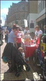 Derby Socialist Party campaign stall in support of Derby Women's Centre 12 August 2017 photo Derby SP