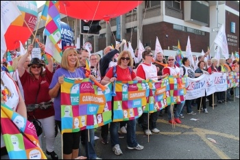 Amy Murphy (holding the end of the banner) on an Usdaw protest, photo Usdaw Activist