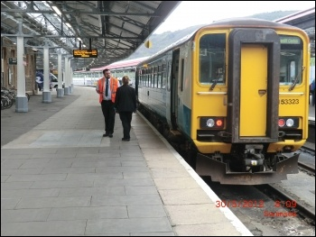 Train guard at Swansea station photo Lobster1/CC, photo Lobster1/CC