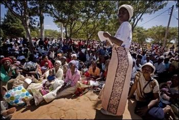 Zimbabwe food queue photo Kate Holt/AusAID/CC
