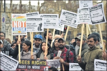 Refugee Rights campaigners marching, photo Mary Finch