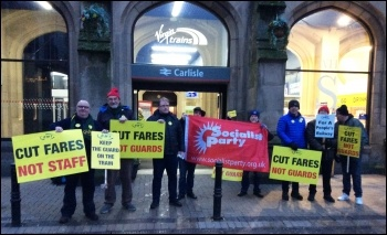 Cut Fares - Not Staff! Carlisle Socialist Party members join RMT and Carlisle Trades Council members outside Carlisle Citadel station on Tuesday 2nd January 2018, photo Craig Johnston