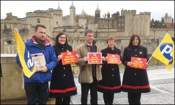 Assistant general secretary Chris Baugh (centre), with PCS members outside the Tower of London for the 31 January PCS pay day protests., photo Paula Mitchell