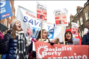 Holding the Socialist Party banner on the 3rd Feb London 'save NHS' demo, photo Mary Finch