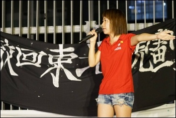 Sally Tang of Socialist Action (CWI Hong Kong) protesting against the dictatorship's arrest of pro-democracy activists and legislators, photo Socialist Action