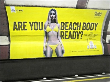 These ads on London Underground were taken down and banned after 60,000 people signed a protest petition online, photo Graham C99/CC