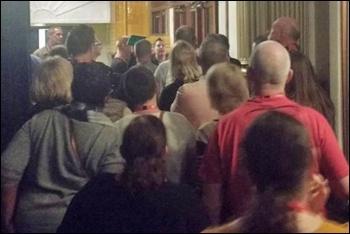 Dozens of delegates walked out to demand proper democratic procedures, photo by Scott Jones