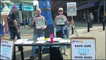 Cait Mallon selling the Socialist, photo Stoke Socialist Party