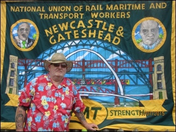 Stan Herschel in 2015 at the Durham Miners' Gala.  Newcastle & Gateshead RMT branch had the banner made with his & Bob Crow's pictures on. Photo by Elaine Brunskill