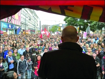 Sascha Stanicic of Sozialistische Alternative addressing the mass anti-racist demo in Berlin, photo SAV