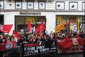 Catering and courier workers on their joint strike rally in Leicester Square, 4.10.18, photo by Scott Jones