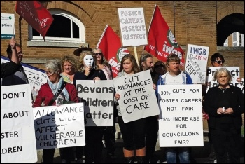 Foster carers and supporters protest outside a Devon Council meeting, photo by Sean Brogan