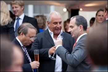 Billionaire retail boss Philip Green (centre) has been accused of racism and sexism towards his workers, photo Financial Times/CC