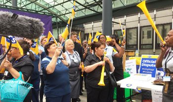 The moment privatised low-paid catering, cleaning, & portering workers walked out on indefinite strike action at the government department for Business, Energy and Industrial Strategy (BEIS), photo Paula Mitchell