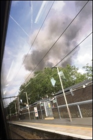 Billowing smoke from the Mall fire visible from the nearby railway station, photo by Ian Pattison