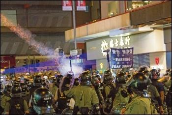 Hong Kong riot police lob tear gas grenades at democracy protesters, photo public domain