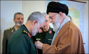 Suleimani being decorated by Iran's supreme leader Ali Khamenei, photo Khamenei.ir/CC