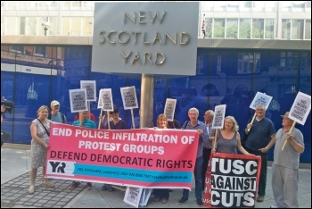 Socialist Party members and trade unionists protesting against political policing at New Scotland Yard, photo by Socialist Party