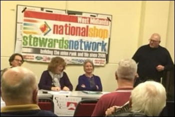 Clive (stood, right) speaking at a Coventry meeting of the NSSN, photo by Socialist Party