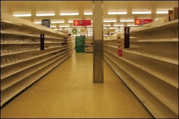 Shelves cleared by profit-hungry supermarkets permitting uncontrolled panic buying, photo by Derek Harper/CC