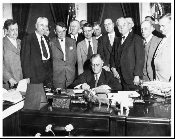 US president Franklin Roosevelt signs an act creating the Tennessee Valley Authority, a federally owned public works corporation