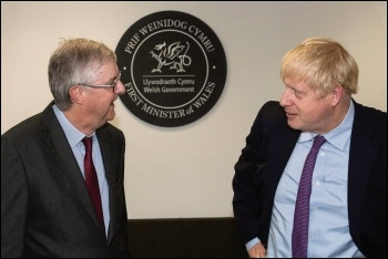 Welsh first minister Mark Drakeford (left) has mostly tailed UK prime minister Boris Johnson (right) on coronavirus strategy, photo OGL v3