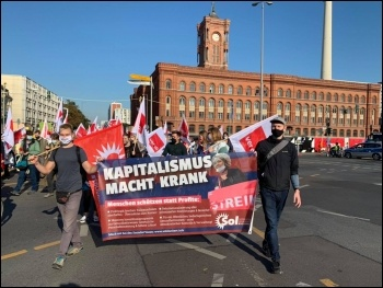 SOL members march with public sector strikers in Berlin, photo SOL